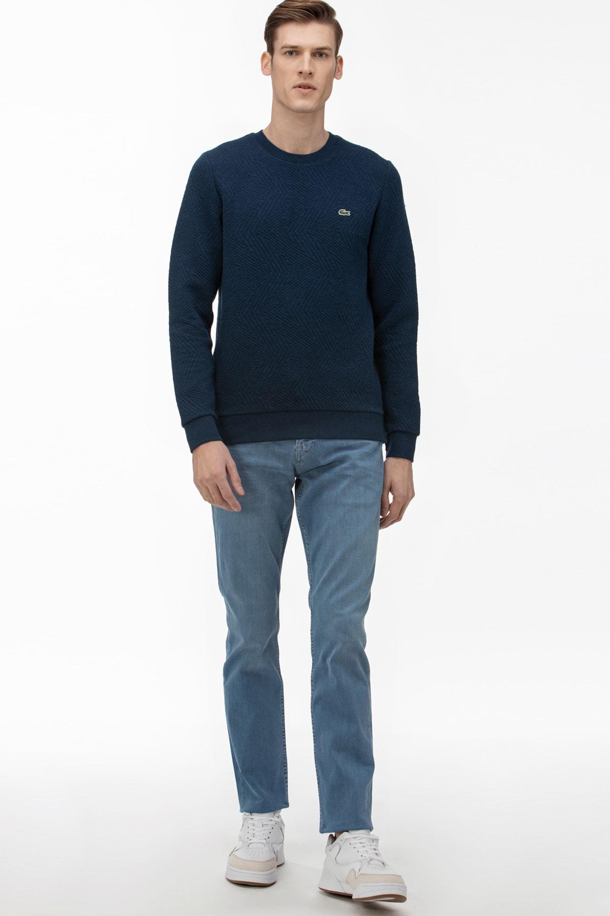 خرید نقدی شلوار جین مردانه برند لاگوست lacoste رنگ لاجوردی کد ty34809632