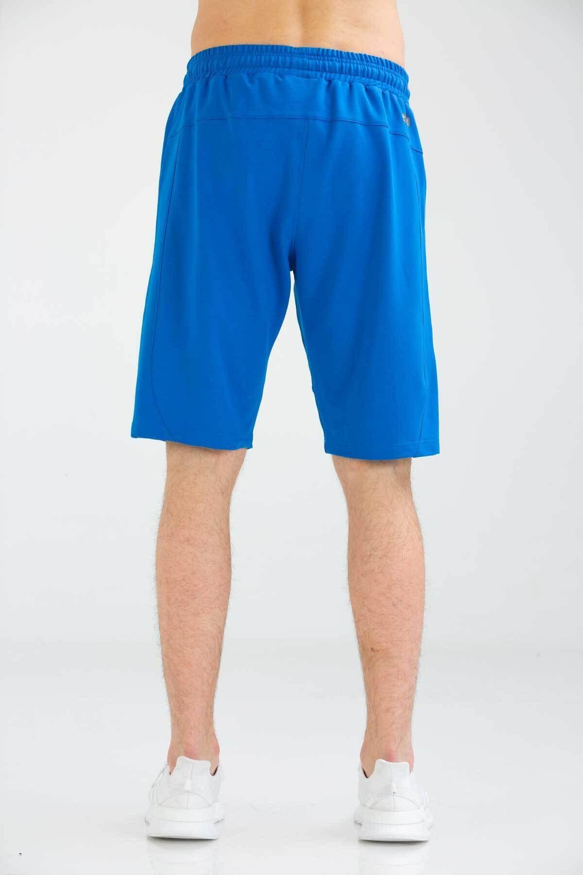 خرید نقدی شلوارک ورزشی مردانه  برند UMBRO رنگ لاجوردی کد ty43875497